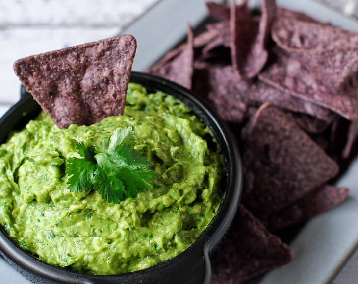 You won't be able to resist double dipping into this guacamole! Try this simple and flavor-packed recipe!