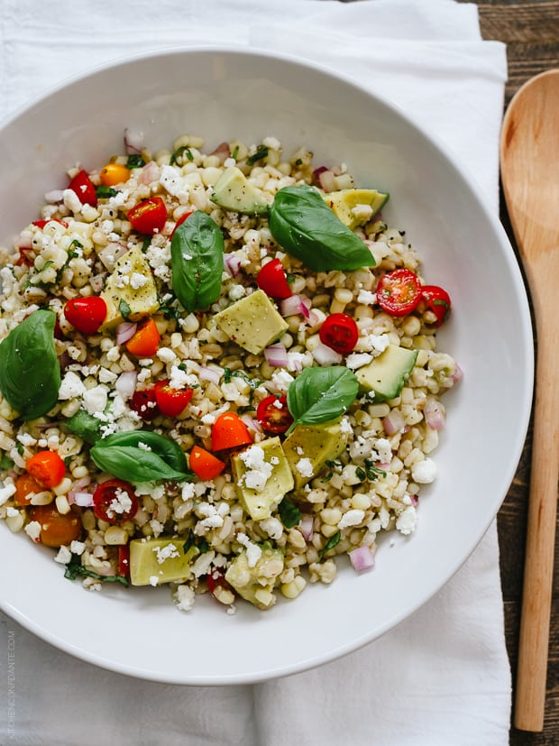 This hearty Summer Corn and Barley Salad is packed with flavor and summer's sweet corn, tomatoes, avocados, and fresh basil. The barley rounds it out for an extremely healthy and fiber rich salad, making it the perfect side to any summer meal.
