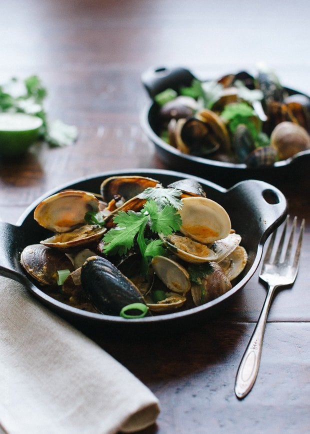 Steamed Clams and Mussels in Coconut Curry Broth | www.kitchenconfidante.com | Clams steam in minutes, making this a perfect appetizer or meal.