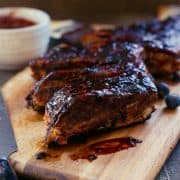Baby Back Ribs with Blueberry Balsamic Barbecue Sauce | www.kitchenconfidante.com | Ribs glazed wi