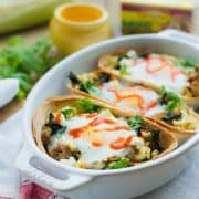Baked Egg Taco Boats with Pulled Pork, Potatoes and Kale   www.kitchenconfidante.com   Taco Tuesday just got more fun! These taco boats are perfect for busy weeknights.