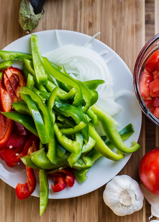 Greek-Style Sausage and Peppers | www.kitchenconfidante.com | You'll love this Grecian take on sausage and peppers!
