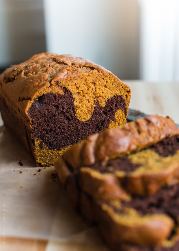 A loaf of Chocolate Marble Pumpkin Bread sliced and ready to eat.