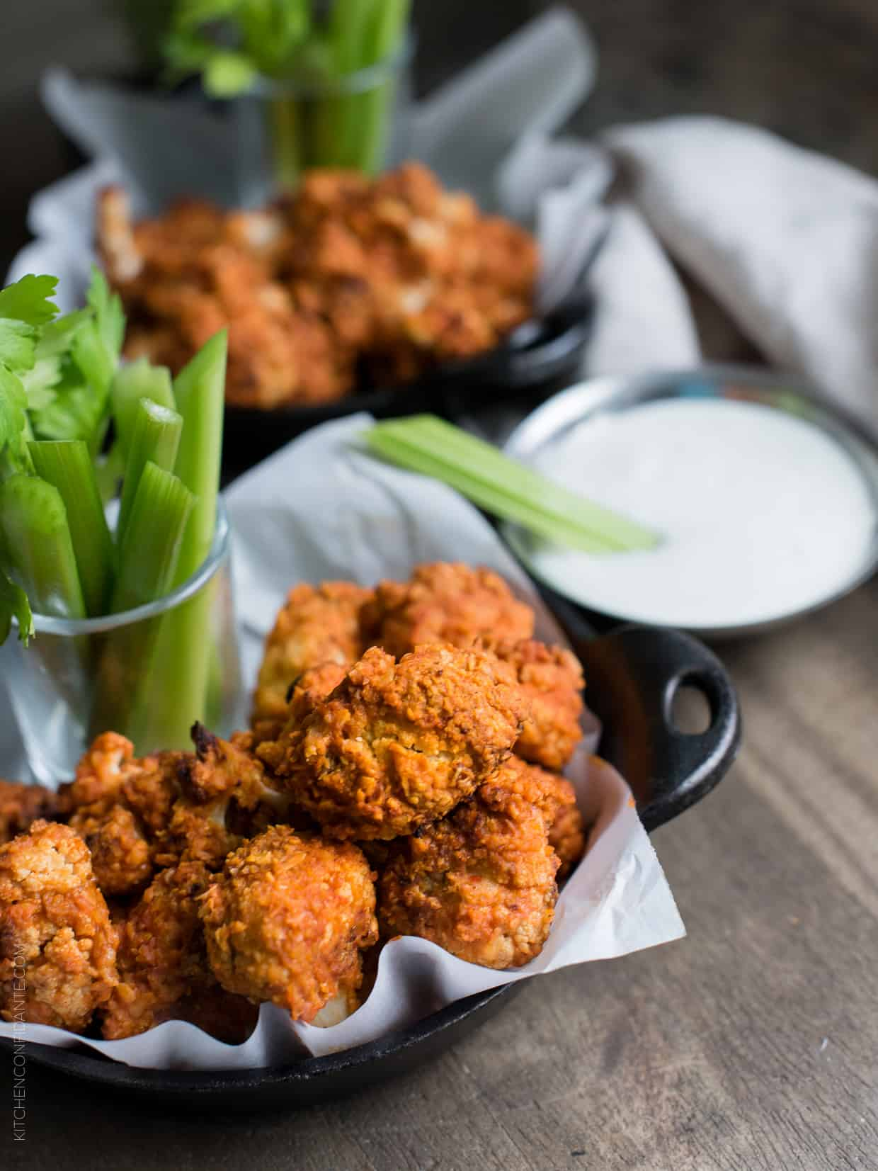 "Hummus Battered Buffalo Cauliflower ""Wings"" - the spicy bite you can indulge in on game day or any day!"