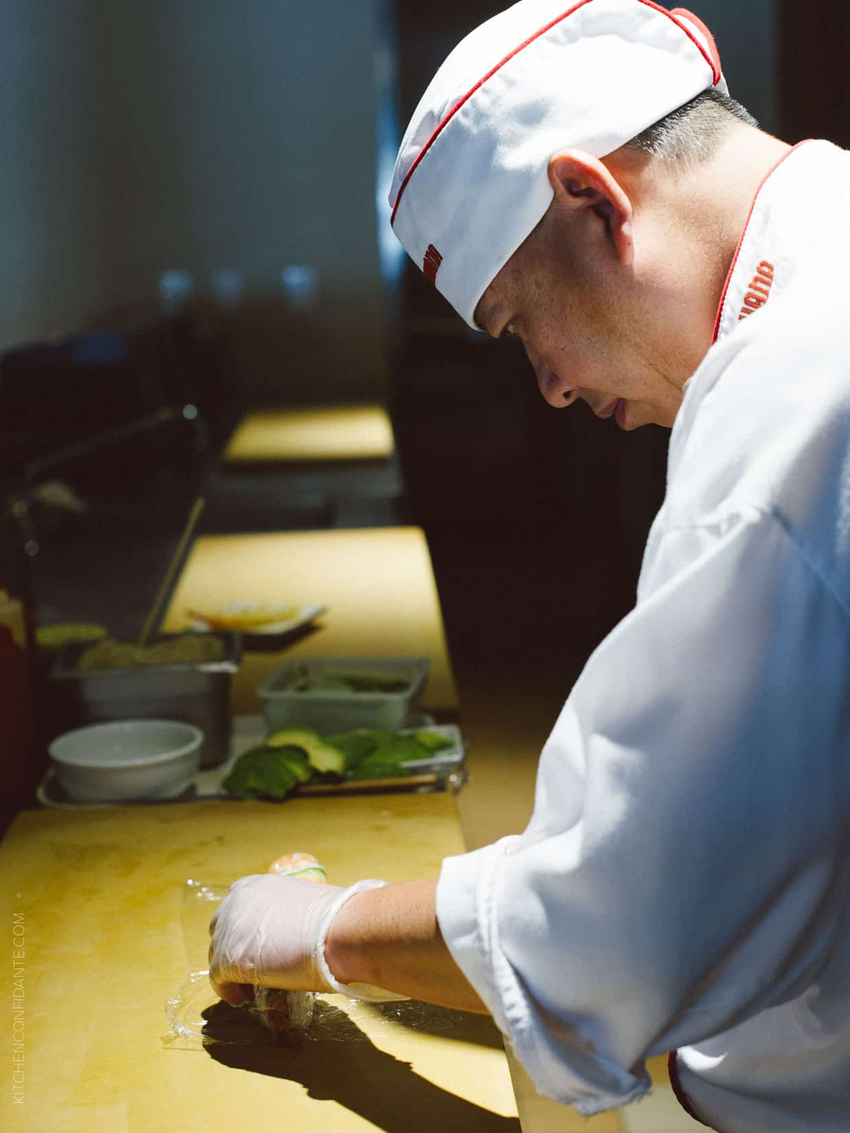 Chefs work their magic to make beautiful sushi.