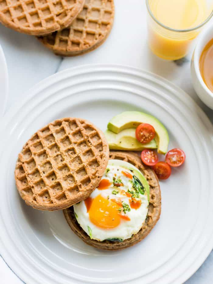 Wholegrain waffles and eggs come together in this easy recipe for Waffle Breakfast Sandwich.