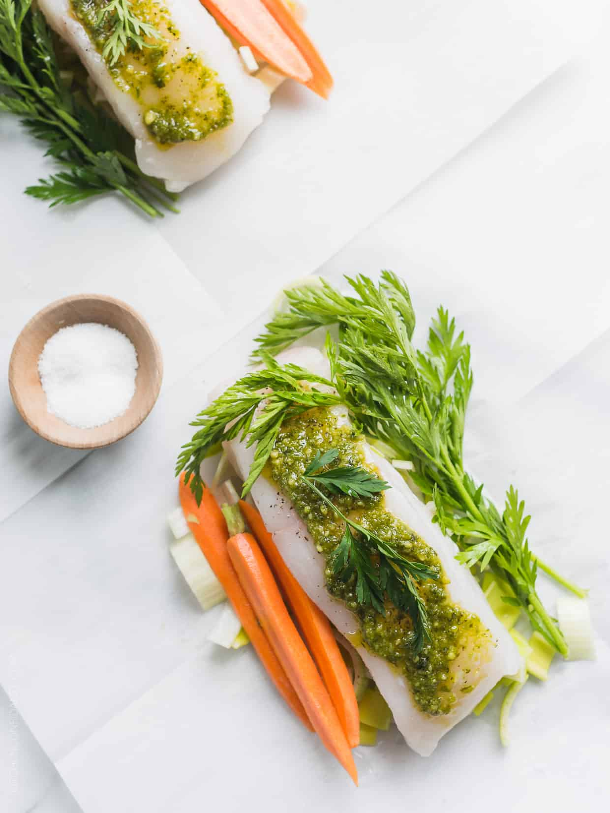 The best part of cooking en papillote? The clean up! Try it in this delicious recipe for Halibut en Papillote with Carrot Top Pesto!