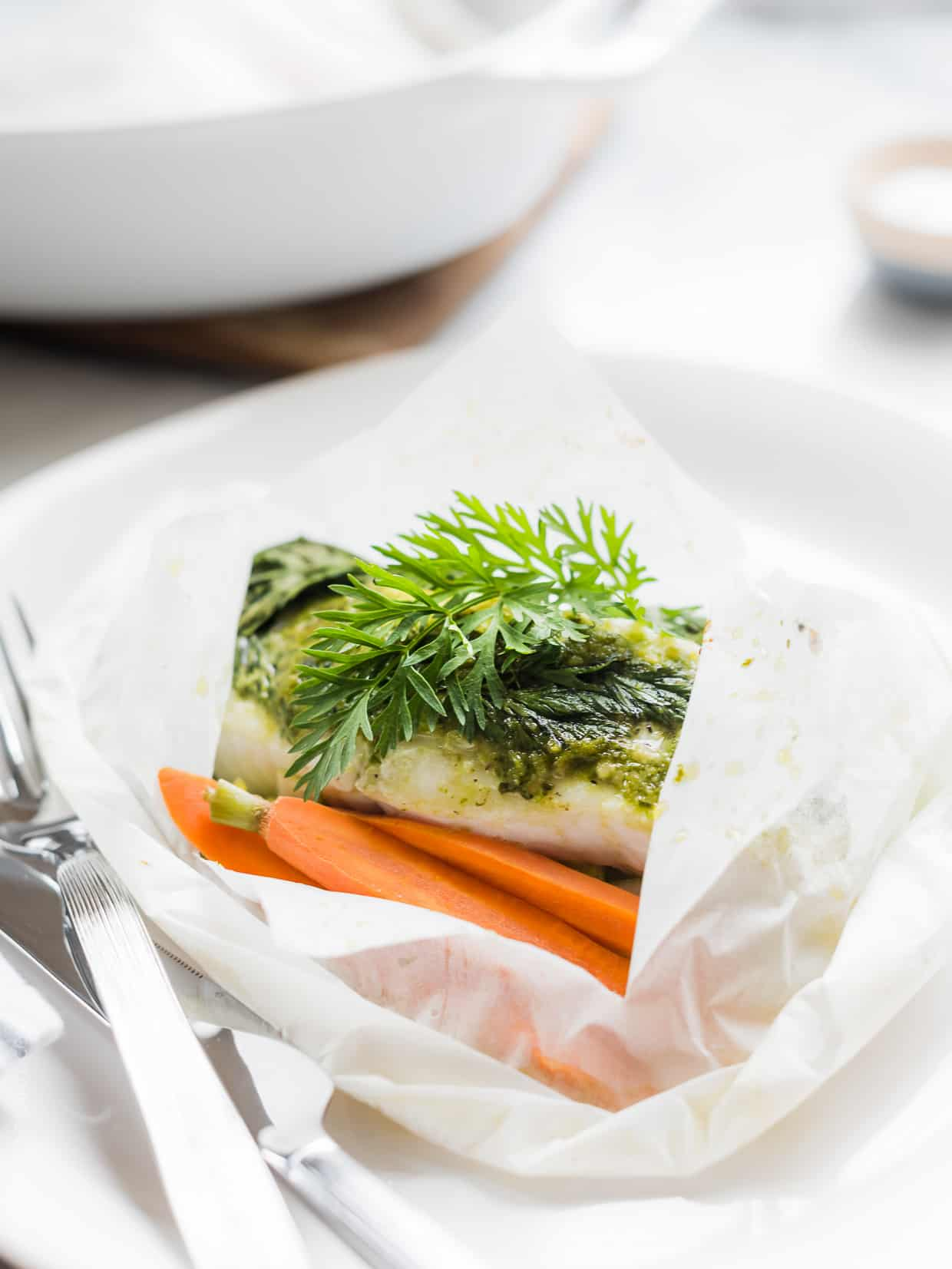 Don't toss those carrot tops! Use them in this deliciously simple Halibut en Papillote with Carrot Top Pesto!