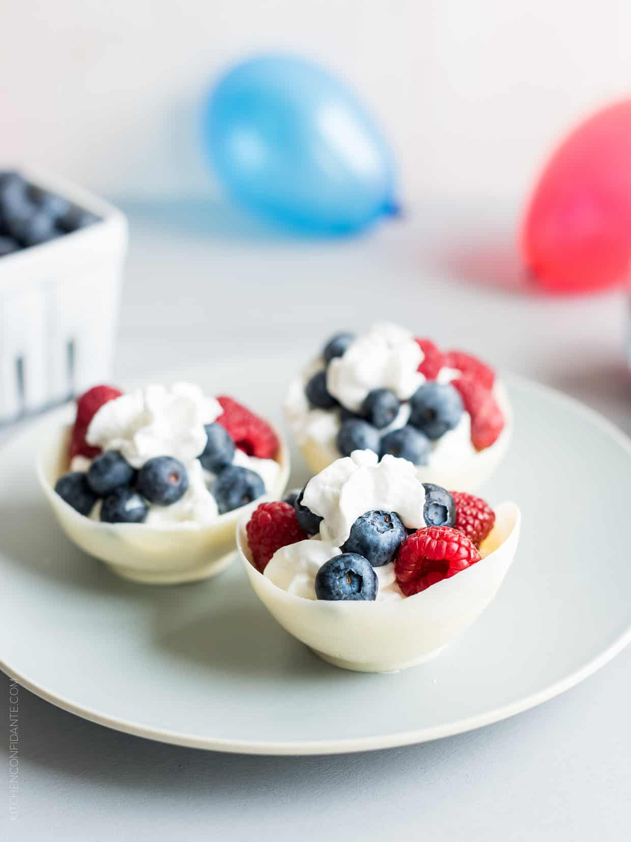 5 Ways to Go Red White and Blue for the 4th of July - these White Chocolate Berry Bowls are so fun and just one way to get festive!