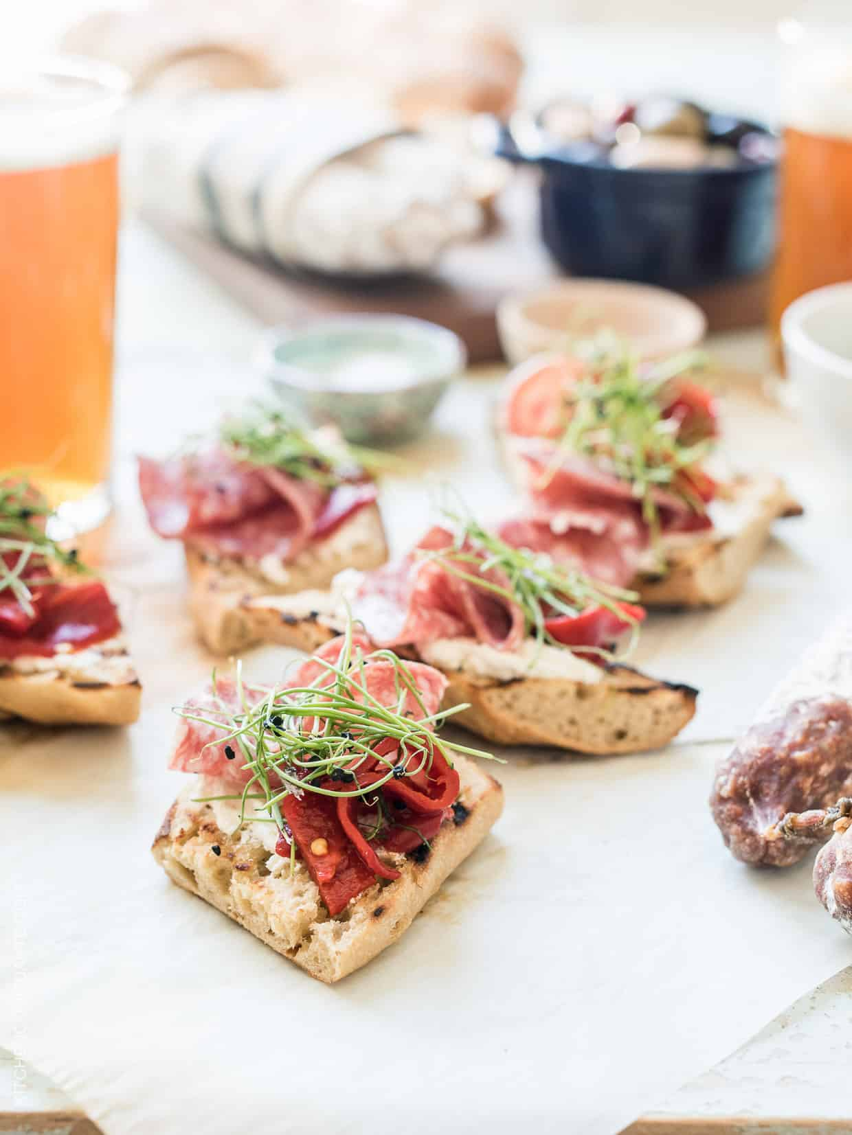 Beer Bread Bruschetta with Salami is my antidote to everything summer: picnics, parties, or light summer meals! You'll love these bites made with homemade beer bread and @columbusmeats #salami - it pairs #craftmeat with craft beer in each bite! #nobaloney #ad