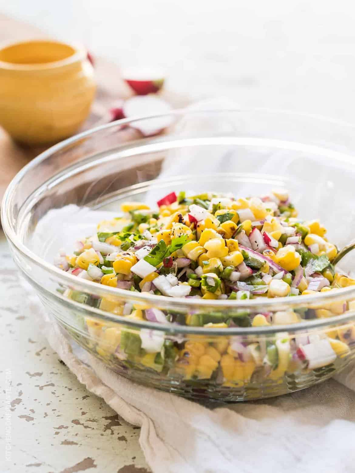Grilled Corn and Poblano Salad in a glass bowl.