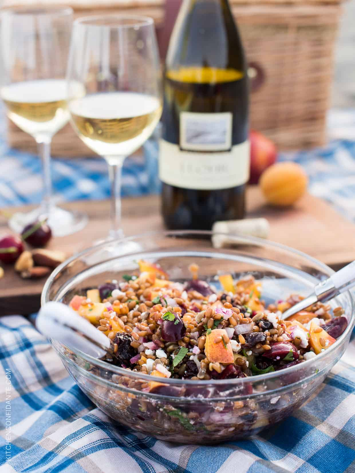Picnic on a California beach with glasses of J. Lohr Chardonnay, Summer Wheat Berry Salad, and fresh cherries.