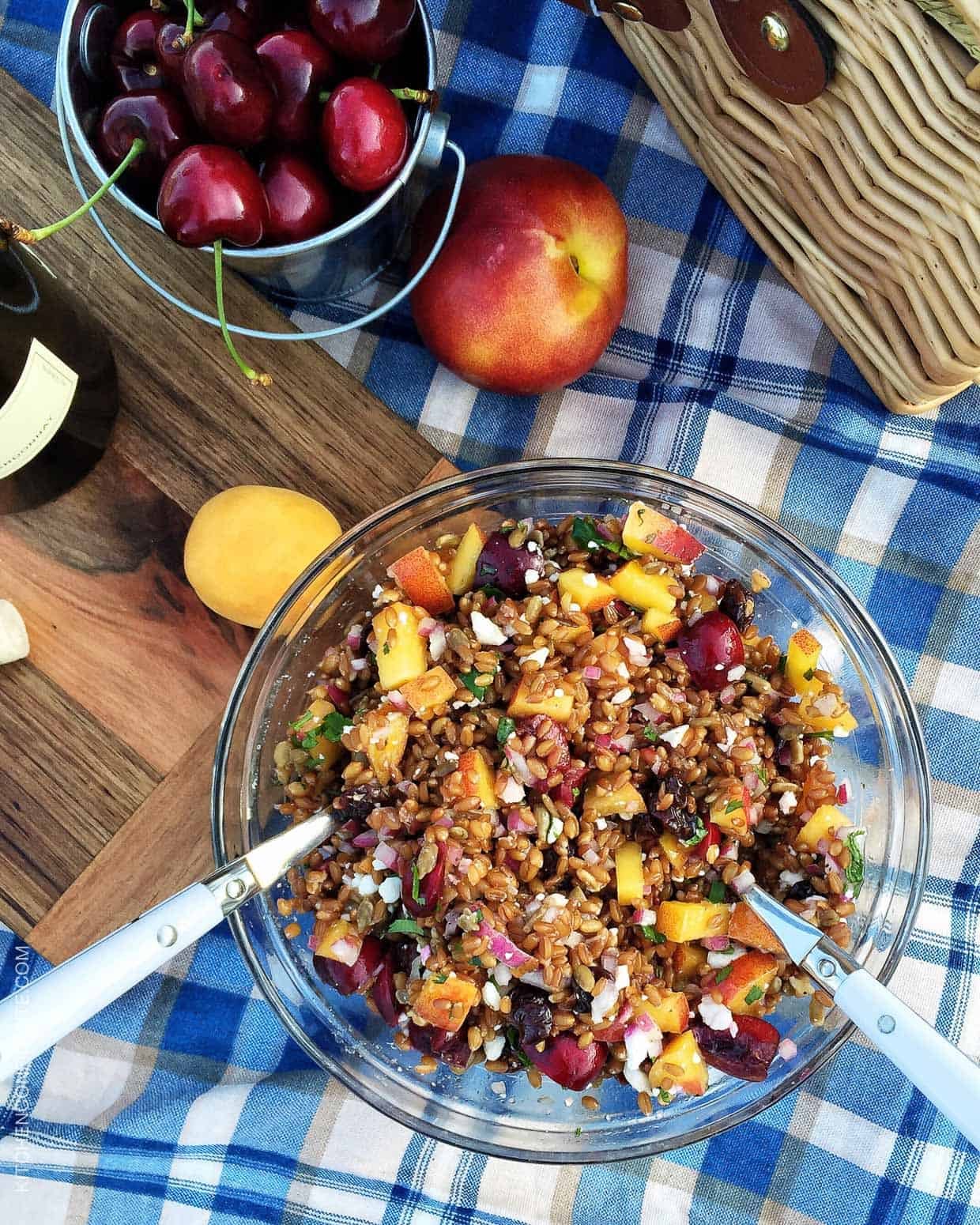 Chopped fresh cherries and nectarines in a bowl of Summer Wheat Berry Salad.