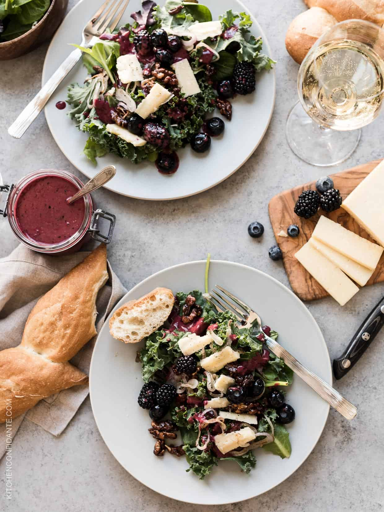 Blackberry and Blueberry Kale Salad with Aged Havarti -- If you love wine and cheese, you'll love pairing them together in this summer salad that goes well with anything that comes off the grill. Chardonnay in the berry wine dressing swirls through each bite of hearty kale and Aged Havarti by @CastelloUSA. #SavortheSummer #ad