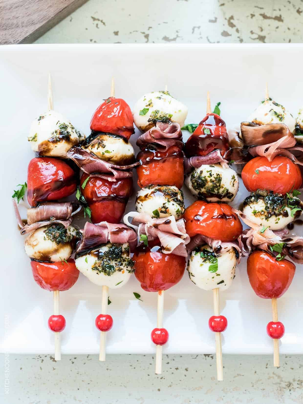 Peppadew Pepper Caprese Skewers with Balsamic Glaze are a perfect appetizer or snack for summer - you'll love this sweet and spicy take on a caprese salad!