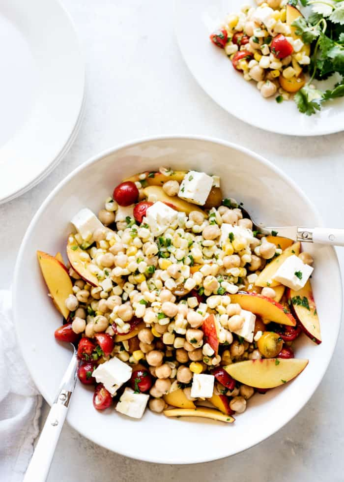 Tomato, Corn and Nectarine Chickpea Salad -- all of your favorite summer fruits and vegetables, in a vibrant summer salad! This is guaranteed to become a go-to all season long.
