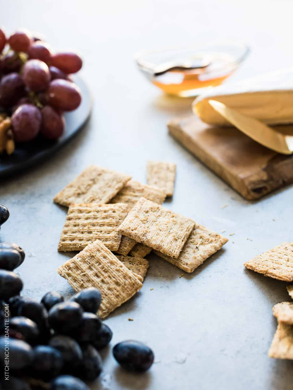 Caramelized Grape, Brie and Walnut Bites: Simple ingredients transform into something delicious on a cracker, making these bites the perfect snack!