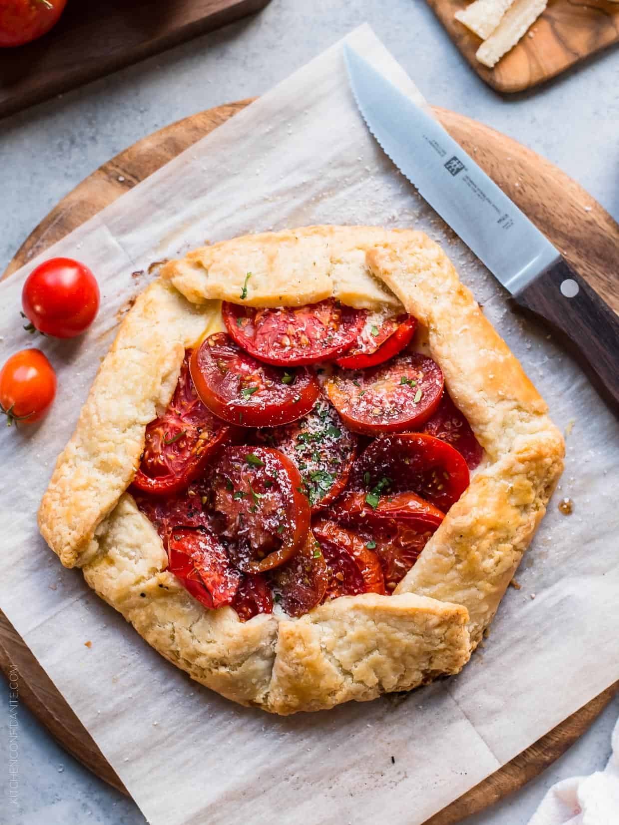 A freshly baked Tomato Ricotta Galette on parchment paper.