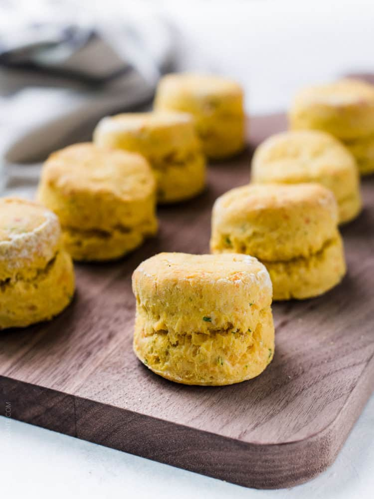 Light, tender and perfectly flakey, these Pumpkin Cheddar Biscuits are the perfect savory side to all your fall soups and stews.