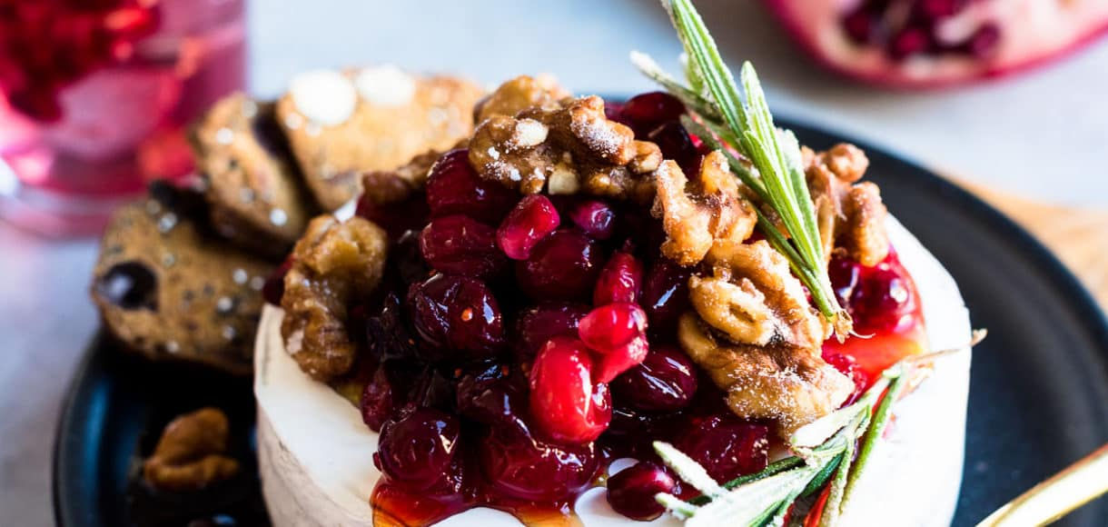 Cranberry Pomegranate Baked Brie - stunning in presentation but so very simple to prepare, this easy appetizer is festive and holiday-ready.