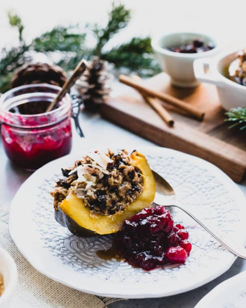 Baked Oatmeal Stuffed Acorn Squash is a wholesome but decadent-tasting main dish for your next holiday brunch! This vegetarian-friendly recipe is packed with baked oatmeal sweetened with a touch of brown sugar and plump prunes.