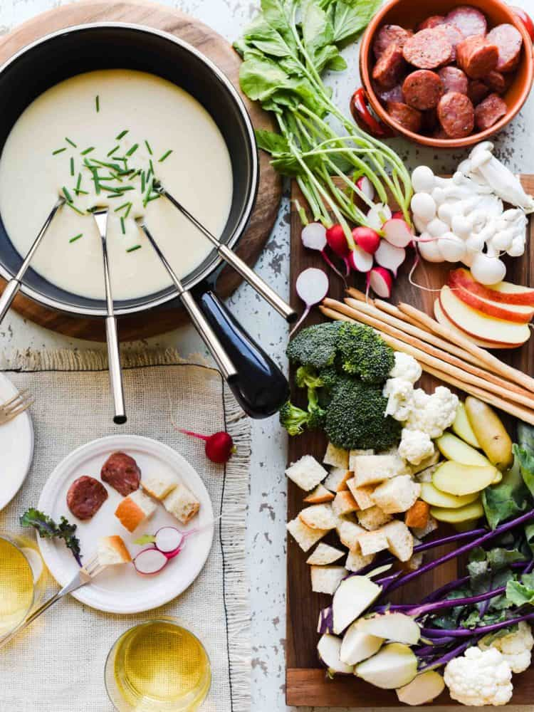 Put the fun in fondue with one of the easiest and most entertaining forms of hosting! Here are some tips to take a dip (literally and figuratively!) in how to host a fondue party made with @EmmiSwissUSA.