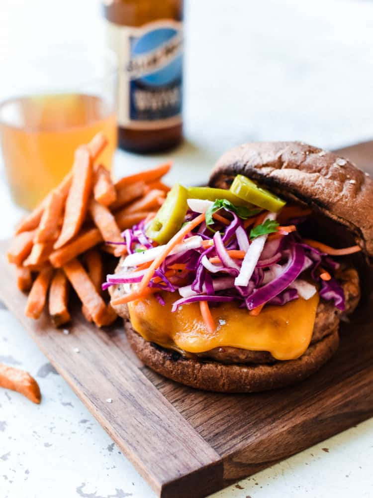 Filipino-style Adobo Burgers are bursting with flavor from marinated pork and turkey ground meat. Top it with a red cabbage and jicama slaw for the ultimate bite!