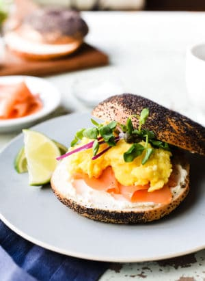 This recipe for Scottish Smoked Salmon Bagel with Scrambled Eggs gives bagel with lox a luxurious update with silky, English-style scrambled eggs.