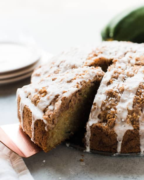 When you have more zucchini than you know what to do with, make cake! This Coconut Zucchini Coffee Cake is beautifully speckled with zucchini, coconut and a delicious crumble.