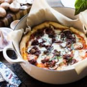 No pizza stone? No worries! Learn how to make pizza in a Dutch oven for perfect pizza baked in the oven, or even when camping!