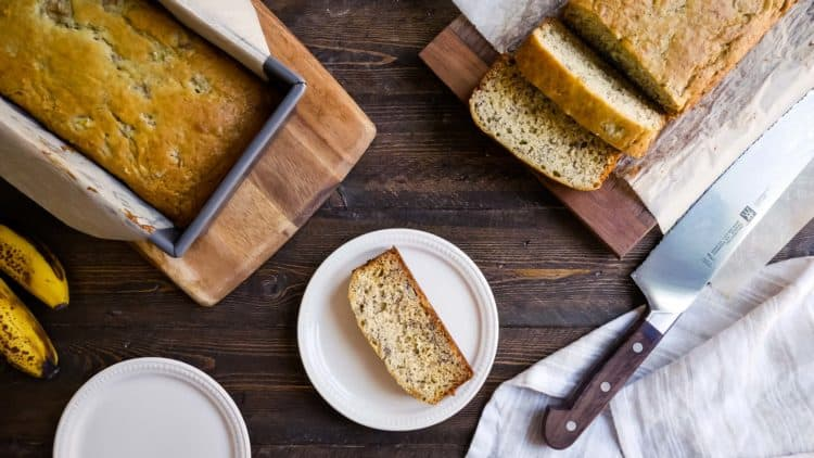 Buttermilk Banana Bread sliced on a cutting board