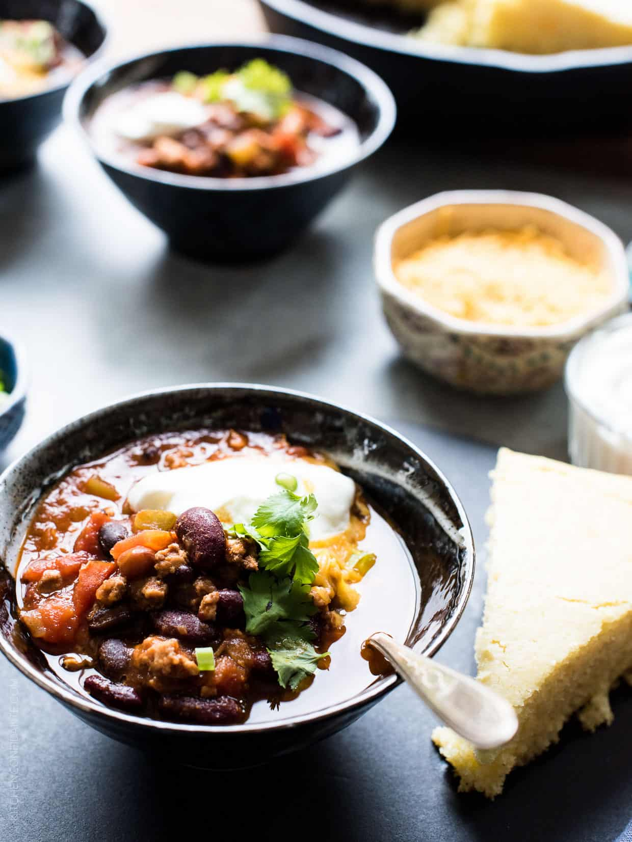 Classic Chili garnished with shredded cheese, sour cream, green onions and cilantro.