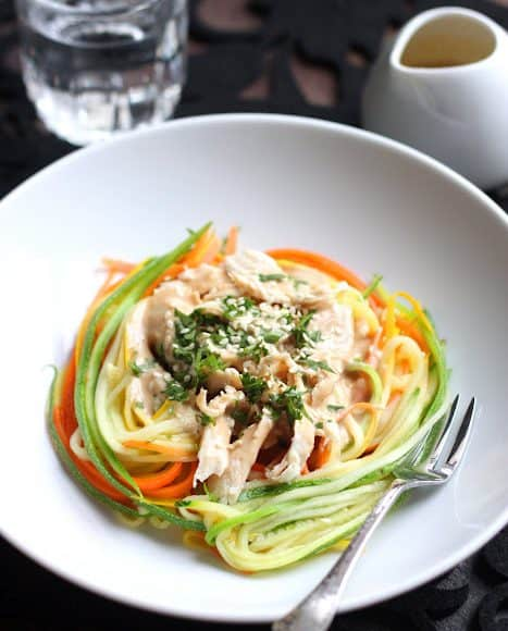 Zucchini Noodles with Chicken and Tangy Peanut Sauce in a white bowl