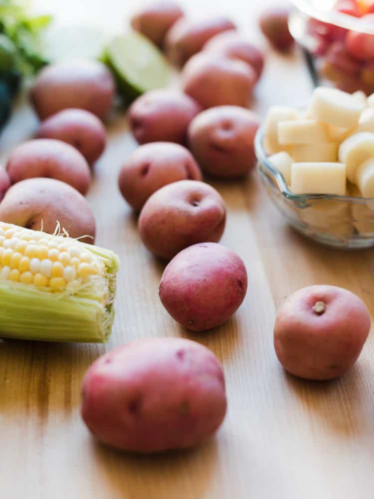 Red potatoes, corn on the cob, and hearts of palm to make Southwestern Potato Salad.