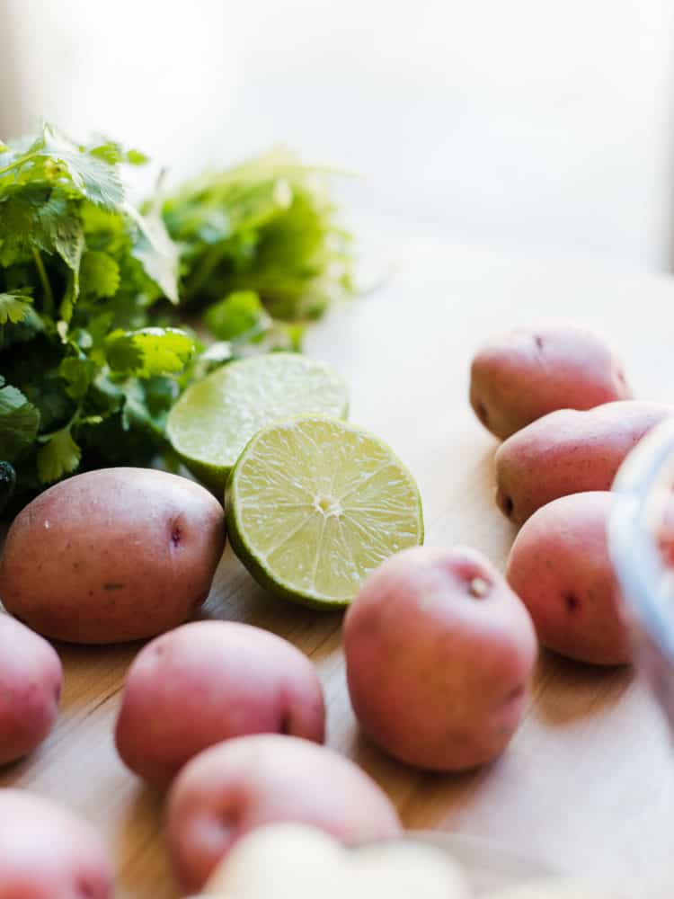 Red potatoes, lime, and cilantro for Southwestern Potato Salad.