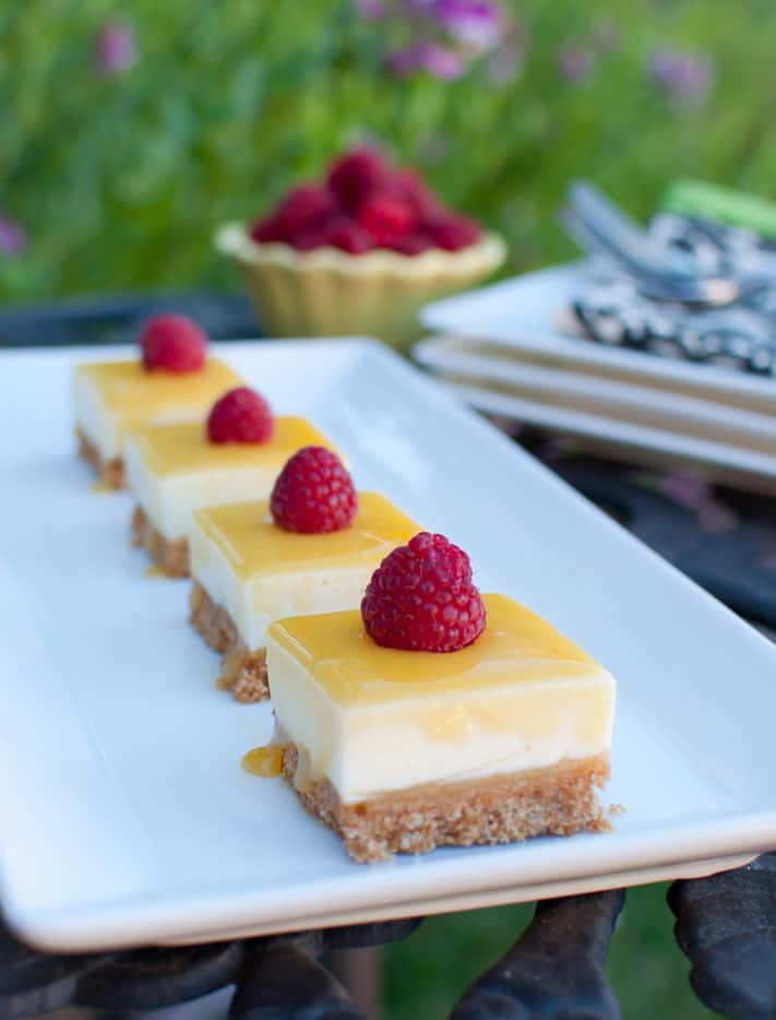 No Bake Lemon Curd Cheesecake Bars are cool and creamy bites of lemon loveliness.