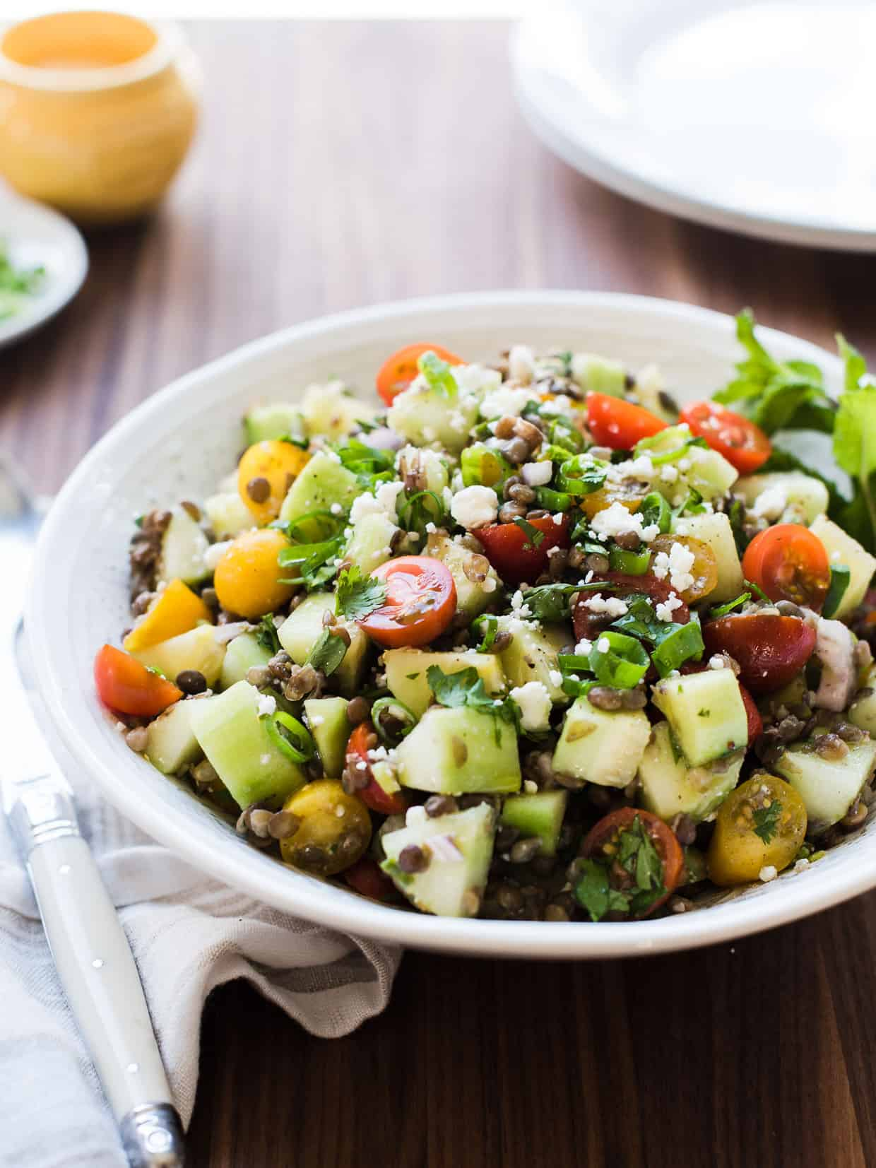 Make the most of tomatoes and cucumbers in this Summer Lentil Salad! It pairs nicely with anything grilled and is a wonderful vegetarian main dish, as well.