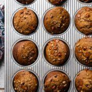 Cinnamon Chip and Walnut Pumpkin Muffins in a muffin pan.