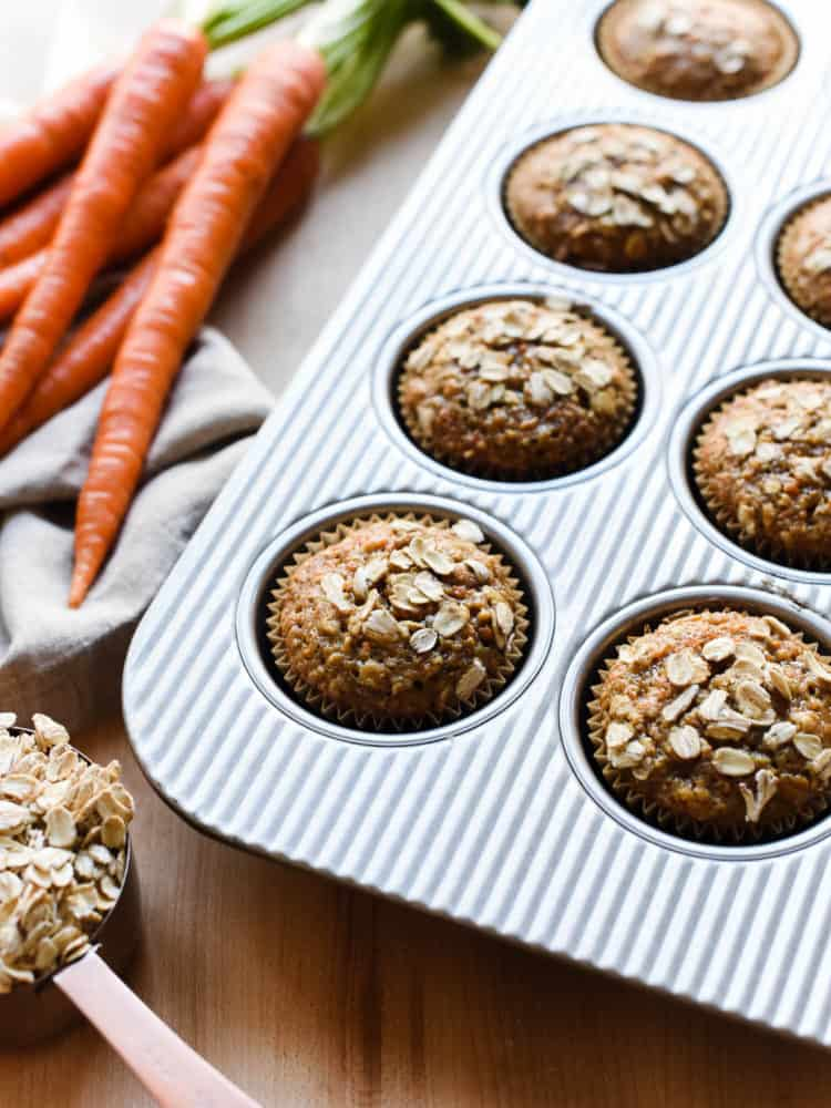 Carrot Oat Muffins in a muffin pan.