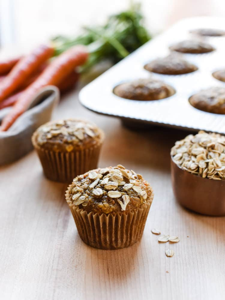 Carrot Oat Muffins on a table.