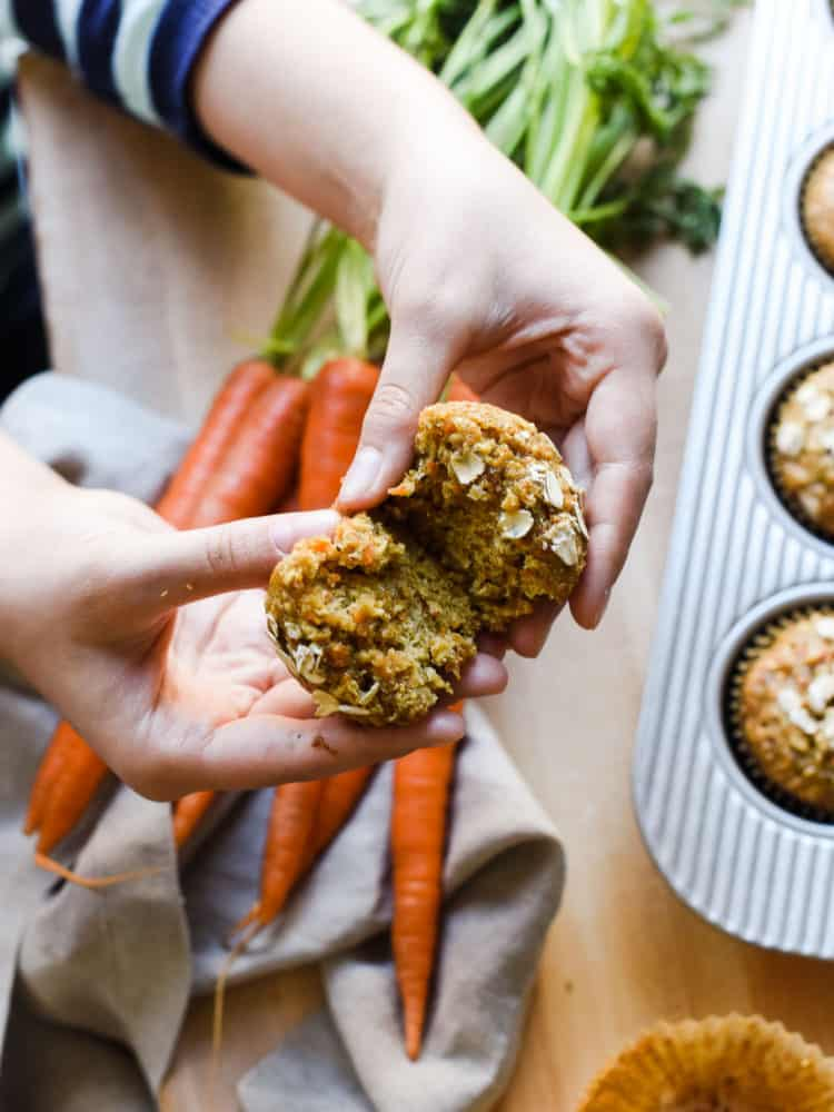 Breaking apart a Carrot Oat Muffin.