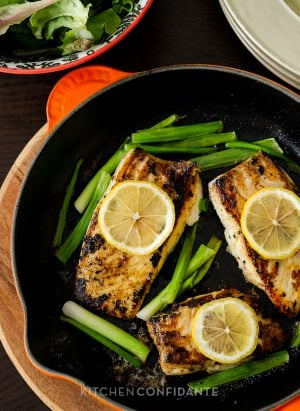 Garlic & Herb Halibut with Scallions | Kitchen Confidante | In Pan