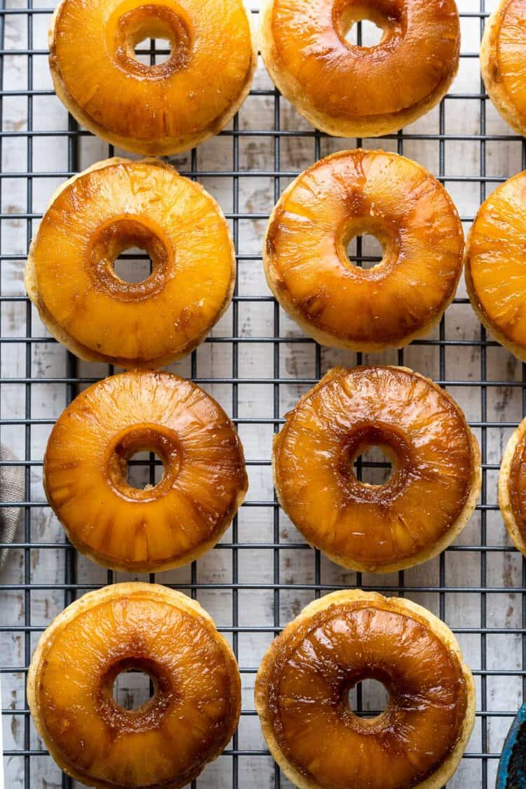 Pineapple Upside Down Cake Doughnuts on a cooling rack.