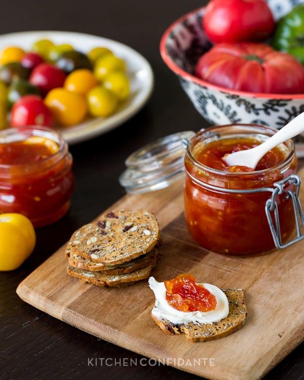 Tomato jam spread on a cracker.