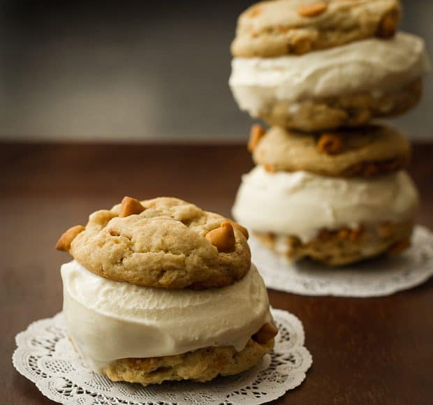 Homemade cookies with vanilla ice cream sandwiched between.