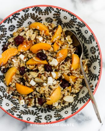 Wild Rice Salad with Apricots, Almonds and Apricot Dressing in a bowl.