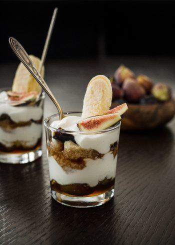 Dessert glasses layered with honeyed figs, ladyfingers, and Greek yogurt cream.