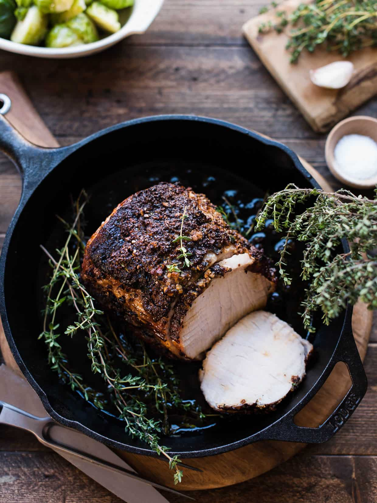 Roast pork loin with balsamic, Dijon and thyme in cast iron skillet.