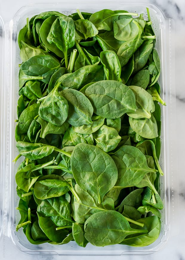 A container of spinach for a Mango Spinach Green Smoothie
