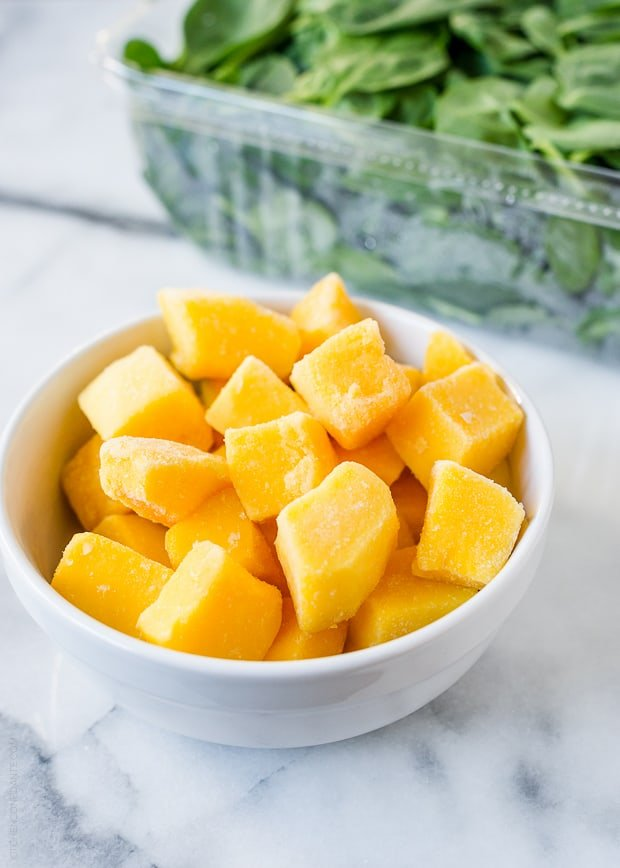 A bowl of mango for a Mango Spinach Green Smoothie